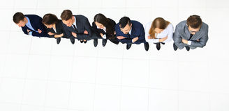 Business people standing in a row. Top view stock photography