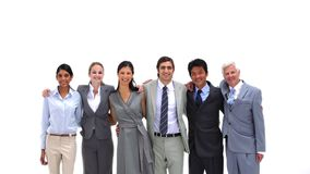 Business people standing shoulders to shoulders Stock Photo