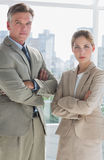 Business people standing with their arms crossed Royalty Free Stock Photos