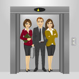 Business people standing together inside office building elevator Royalty Free Stock Photos