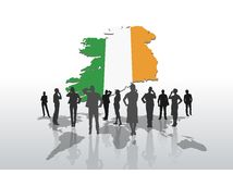 Business people standing under ireland graphic Royalty Free Stock Photos