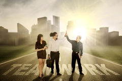 Business people standing on word of teamwork Stock Photography