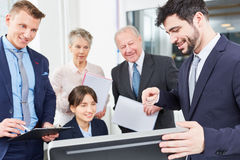 Business people stare at computer Royalty Free Stock Image