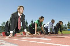 Business People At Starting Blocks Stock Image