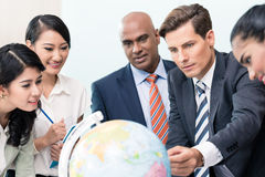 Business people in Strategy meeting discussing new markets Royalty Free Stock Image