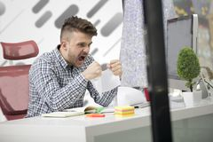 Business, people, stress, emotions and fail concept - angry businessman throwing papers in office.  Stock Photography