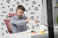 Business, people, stress, emotions and fail concept - angry businessman throwing papers in office.  Stock Photos