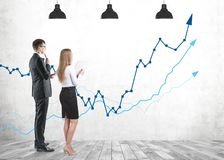 Business people studying growing graph royalty free stock photos
