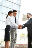 Business People. Successful Team Celebrating a Deal Stock Photo