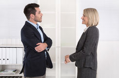 Business people in suit and dress talking together: small talk. Royalty Free Stock Photos