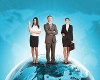 Business people in suit standing on Earth surface. Background is world map with blue gradient. Elements of this image furnished by NASA Stock Photos