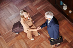 Business people with suitcase making handshake Royalty Free Stock Images