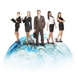 Business people in suits standing on Earth. Isolated on white background. Elements of this image furnished by NASA Royalty Free Stock Images