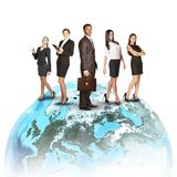 Business people in suits standing on Earth. Isolated on white background. Elements of this image furnished by NASA Stock Photography