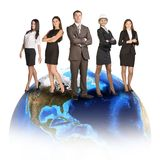 Business people in suits standing on Earth Royalty Free Stock Image