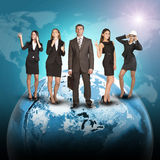 Business people in suits standing on Earth Royalty Free Stock Photography