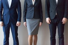Business people in suits standing in row, close up view royalty free stock photography