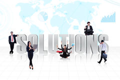 Business global solutions. Business people surround the word SOLUTIONS on world map background Royalty Free Stock Image