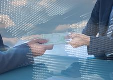 Business people swapping money with map graphic overlay against sky Stock Image