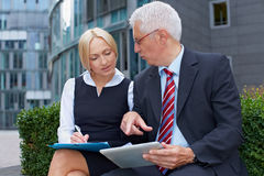 Business people with tablet Royalty Free Stock Photography