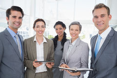 Business people with tablet and notebook Royalty Free Stock Photo