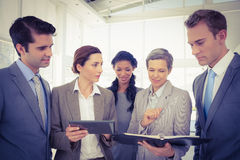 Business people with tablet and notebook Royalty Free Stock Image