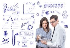 Business people with tablet over success symbols Royalty Free Stock Photo