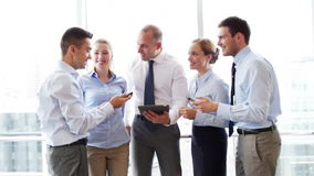 Business people with tablet pc and smartphones stock video