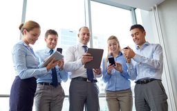 Business people with tablet pc and smartphones Royalty Free Stock Photo