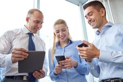 Business people with tablet pc and smartphones Royalty Free Stock Image