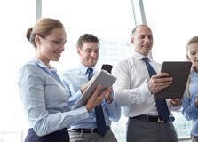 Business people with tablet pc and smartphones Royalty Free Stock Photography