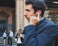 Business people take part in a flash mob in Milan, Italy Stock Image