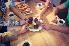 Business people taking cakes on table Royalty Free Stock Images
