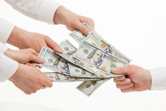 Business people taking money from businessman's hand Stock Image