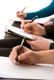 Business people taking notes Royalty Free Stock Photo