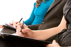 Business people taking notes Stock Photography