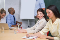 Business people taking notes at presentation Stock Photos