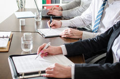 Business people taking notes Stock Image