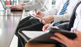Business people taking notes. During a training Stock Photos