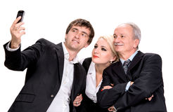 Business people taking picture of themselves Royalty Free Stock Photos