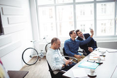 Business people taking selfie in meeting room. Smiling business people taking selfie in meeting room at creative office Royalty Free Stock Photos