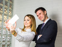 Business people taking selfie with phone Royalty Free Stock Photo