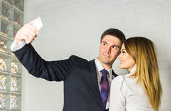Business people taking selfie with phone Stock Image
