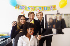 Business People Taking Selfie With Phone At Office Party Royalty Free Stock Photography