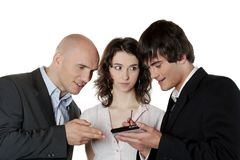Business People Talking. Three young business people - a woman and two men discussing over a pda - detail Royalty Free Stock Photography