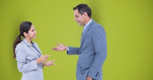 Business people talking against green background. Digital composite of Business people talking against green background Stock Image