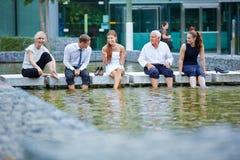 Business people talking during break in summer Stock Image