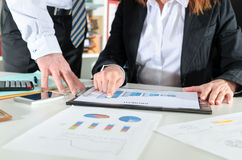 Business people talking about business performance Royalty Free Stock Image