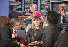 Business People Talking in Cafe Stock Image