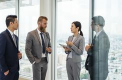 Business people talking and discussing corporate plans stock photos